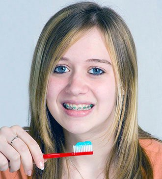 welch orthodontics brushing teeth image