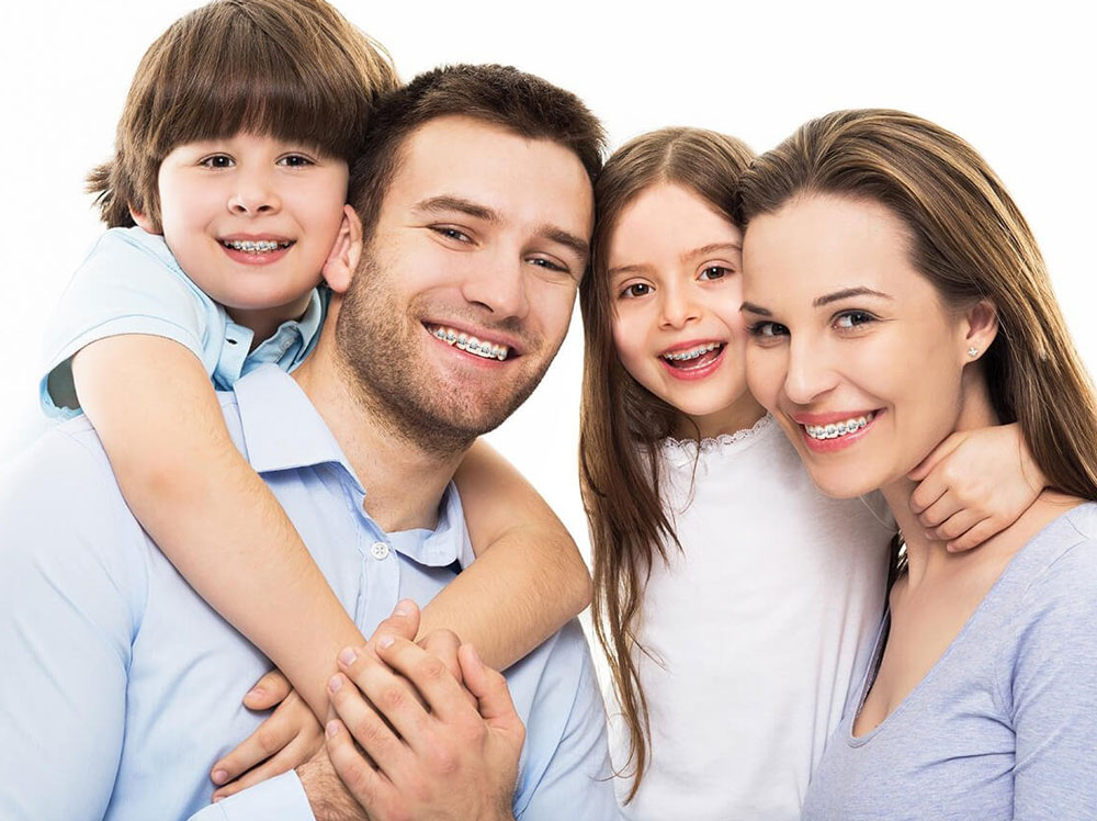 family wearing braces image